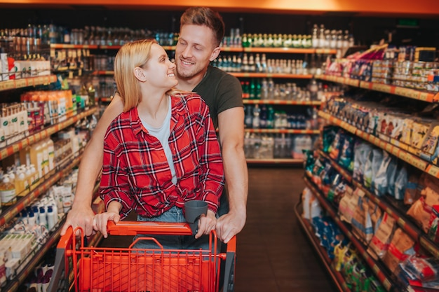 Young couple in grocery store