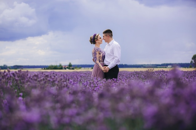 Young couple having fun in a lavender field