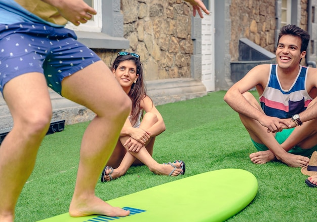 Young couple having fun in a summer surf class outdoors. holidays leisure concept.