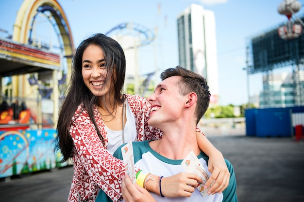 Young couple having fun together at an amusement park