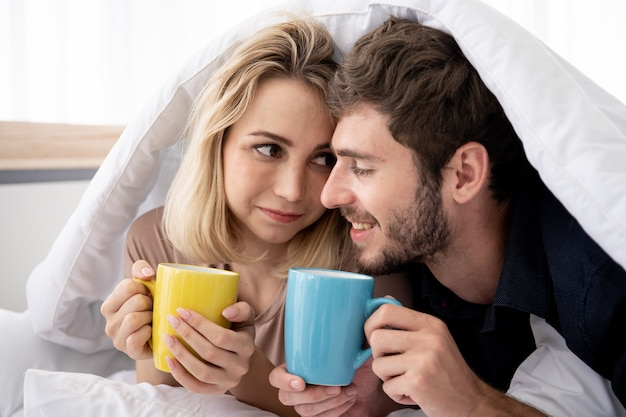 Young couple having romantic moment and drinking coffee in the morning