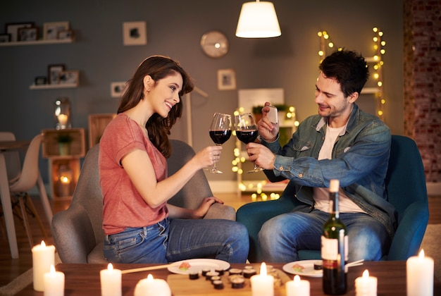 Young couple having toast for lovely evening