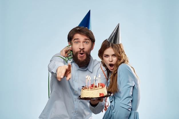 Young couple holding cake holiday fun fun birthday