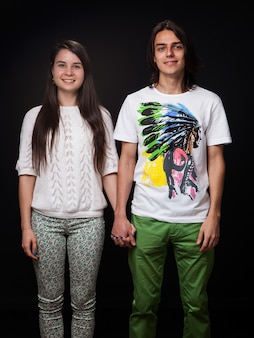 Young couple holding hands on dark