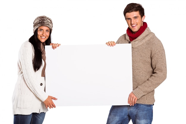 Young couple holding a poster