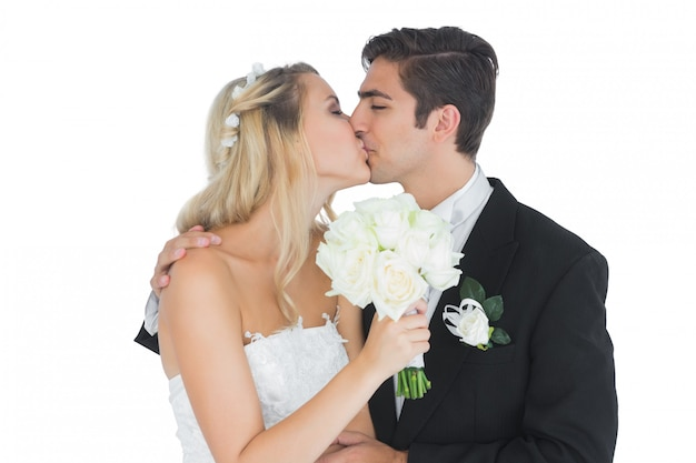 Young couple holding a white bouquet