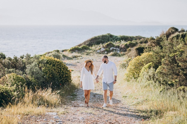 Young couple on honeymoon in greece by the sea