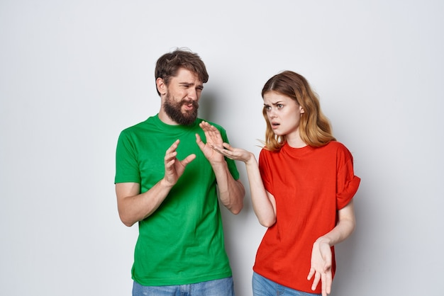 A young couple hug friendship colorful tshirts family light background