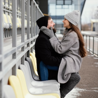 Young couple hugging on bench