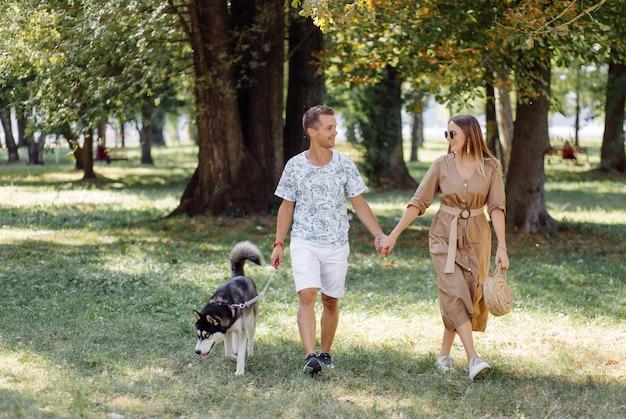 Young couple and husky
