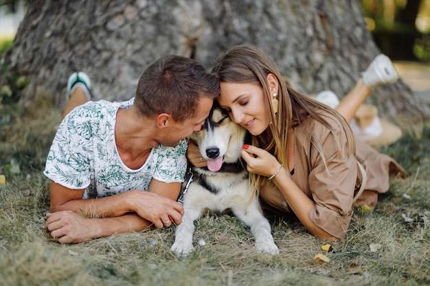 Young couple and husky