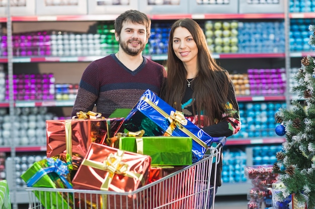 A young couple is shopping at the supermarket for the new year.