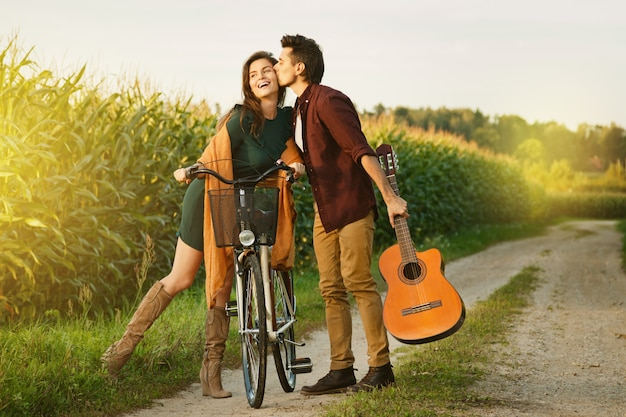Young couple is walking by country road