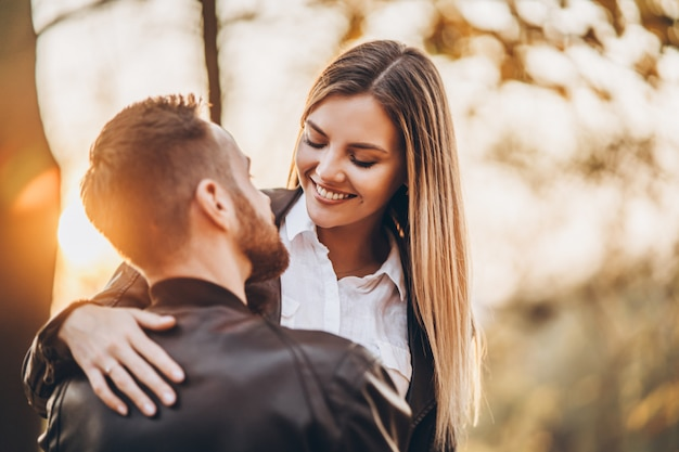 Young couple kissing in autumnal park