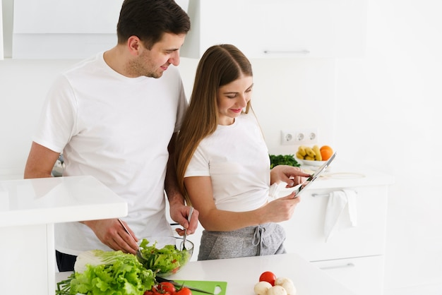 Young couple in kitchen cooking