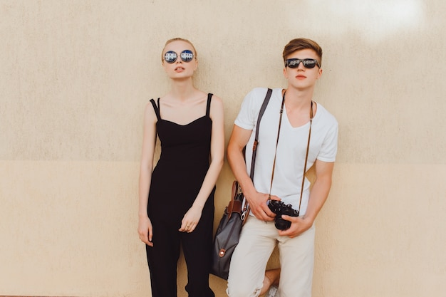 Young couple leaning against a wall
