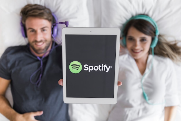 Young couple listening music with spotify app