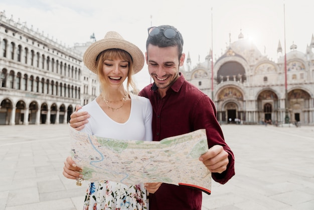 Young couple looking on a map