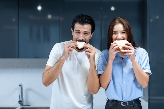 Young couple in love. attractive woman and hansome man cooking at kitchen