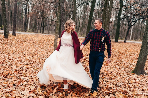 Young couple in love celebrate their little wedding in autumn