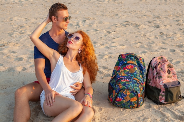 Young couple in love happy on summer beach together having fun
