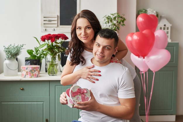 Young couple in love at home celebrating valentine's day