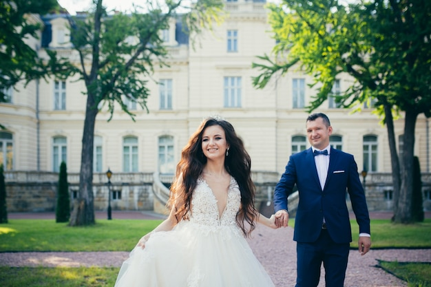 Young couple in love hugging and smiling, wedding photo, bride and groom