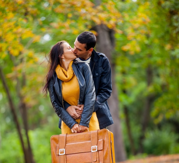 Young couple in love kissing at autumn season outdoor