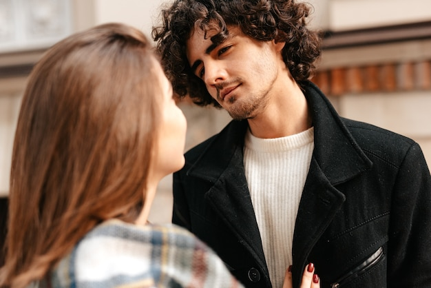 Young couple in love looking into each others eyes
