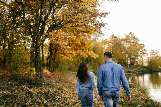 Young couple in love. a love story in the autumn forest park