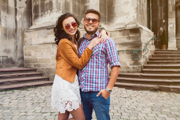 Young couple in love posing in old town