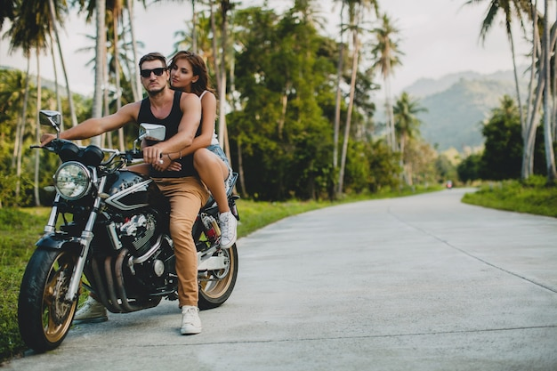 Young couple in love, riding a motorcycle