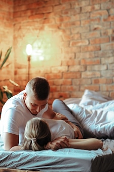 Young couple in love spending time together. beautiful woman and handsome man having intimate moments at home