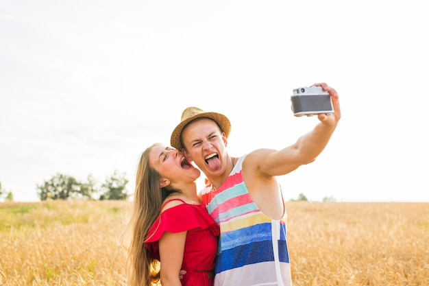 Young couple in love taking selfie outdoors