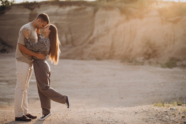 Young couple in love together in quarry