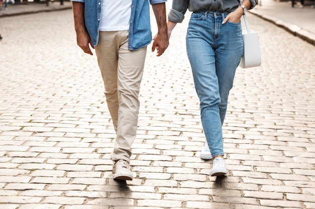 Young couple in love walking outdoors at the city street