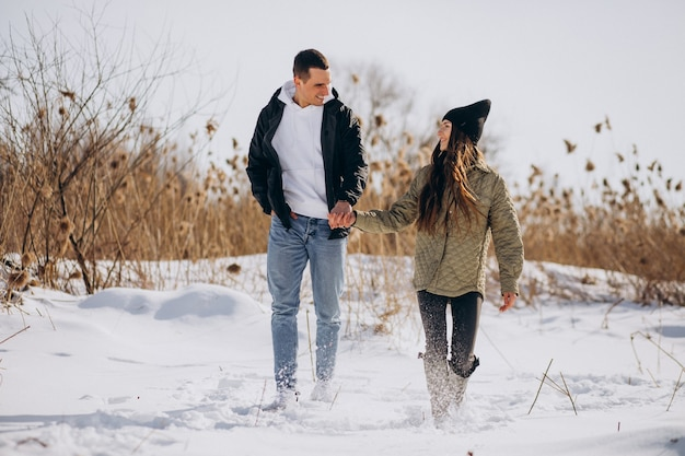 Young couple in love walking in winter time