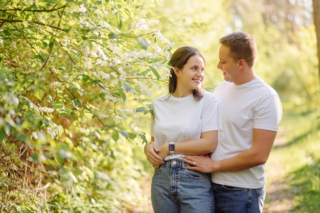 A young couple in love walks in the woods, having a good time together