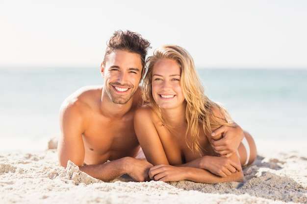 Young couple lying on sand