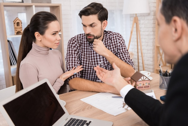Young couple makes decisions regarding purchase of house