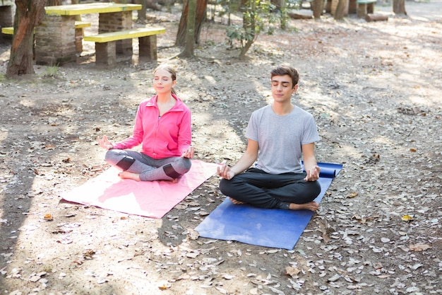 Young couple meditating after a hard week