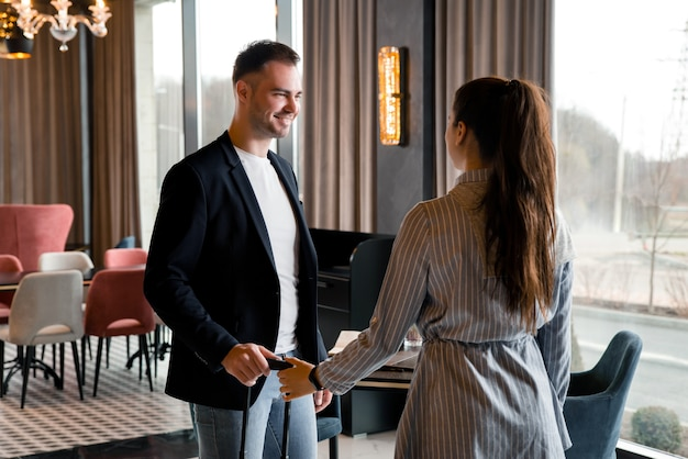 Young couple meeting in hotel lobby after separation