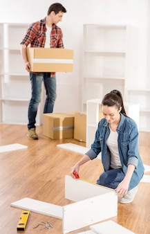 Young couple moving in new home house.