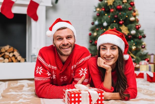 Young couple near christmas tree