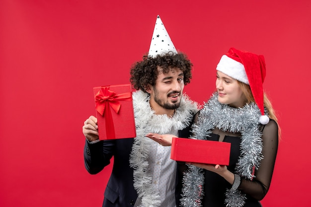 Young couple opening new year present christmas love party