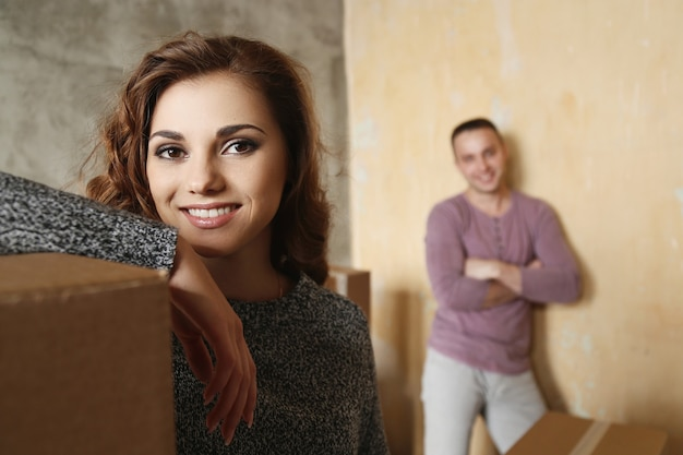 Young couple packing things to move to a new place and having fun