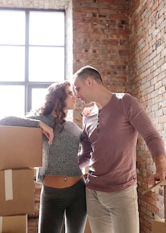 Young couple packing things and moving to a new place