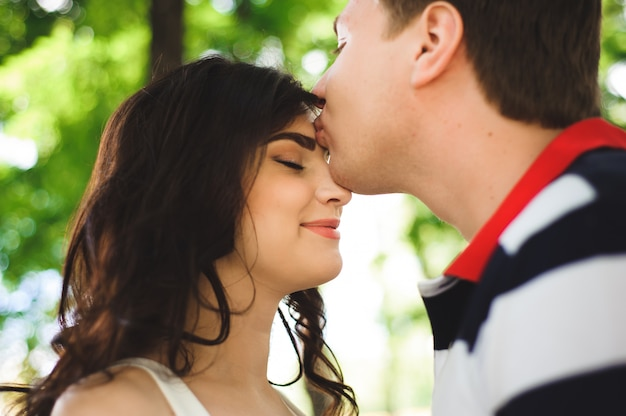 Young couple at the park in summer day