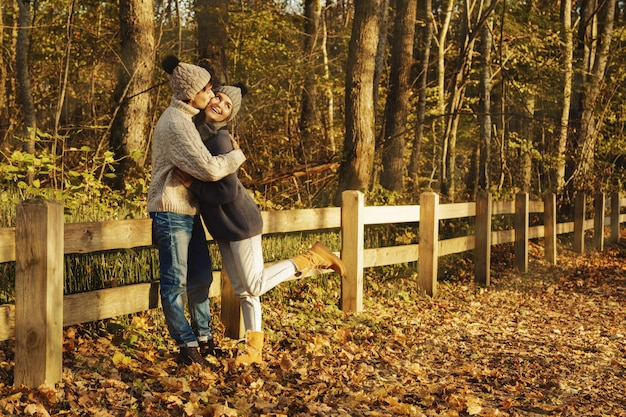 Young couple in the park at sunny autumn day