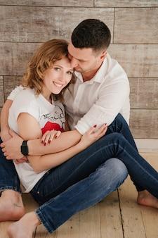 Young couple portrait. beautiful pretty woman hugging handsome man. sensual photo